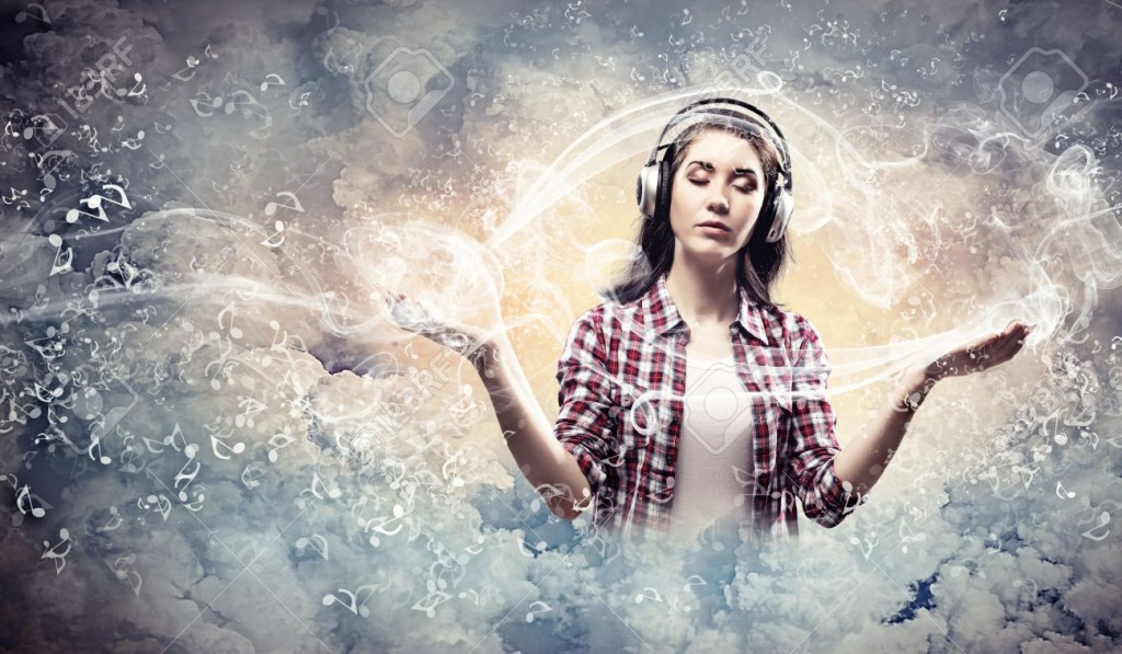 21404383-image-of-young-pretty-woman-with-headphones-meditating